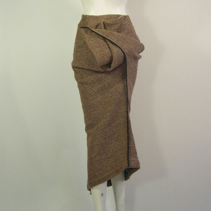 Vintage Junya Watanabe Concept Tweed Skirt for Comme des Garcons 1999. Conceptual designer, Junya Watanabe takes a bog-standard tweed skirt and reinvents its form by disconnecting with traditional construction.