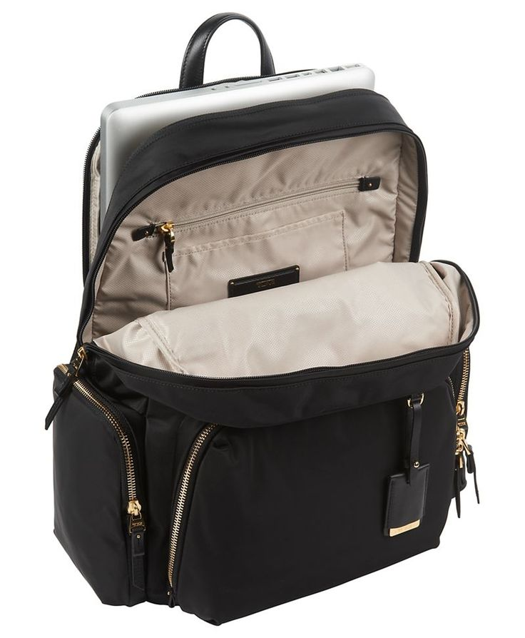 The best-selling Voyageur collection offers streamlined and sophisticated feminine styling with smart details in lightweight designs. Practical, pretty and versatile, this backpack is ideal for business, travel and everyday outings. It has a laptop (15) pocket and other interior organizer pockets for electronics and personal accessories. Several exterior pockets for fast-access items. Made from lightweight nylon with leather trim, it has a leather carry handle and padded shoulder straps.