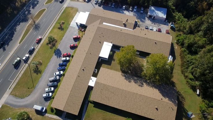 A complete shingle replacement project using GAF roofing products. We repaired damaged areas and applied silicone roof coating over flat areas of the roof.