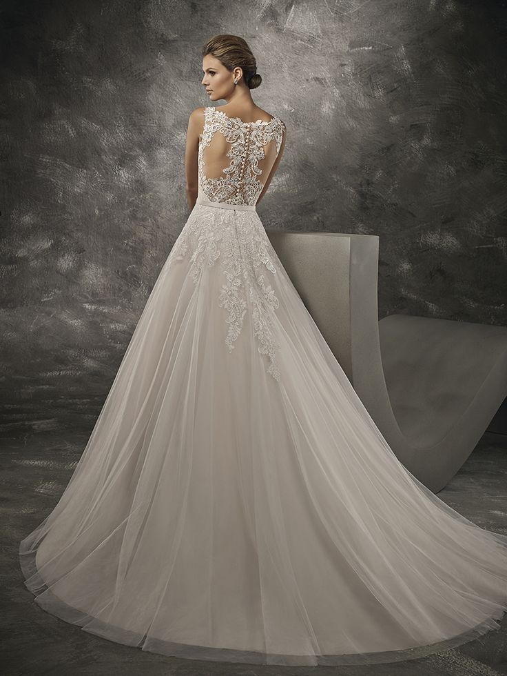 """In the """"Piper"""" wedding dress, you are guaranteed to feel like a princess on your big day. This A-line style truly has the most exquisite combination of lace and beadworkadorning the bodice, as well as the back which features sheer illusion panels and buttons. A sweetheart neckline alludes to femininity. In the soft tulle skirt, you will feel like you're walking on air.  #weddingwhispers #wedding #weddingdress #adelaidewedding #adelaideweddings #lace #sheerillusion #train #bride #bridetobe…"""