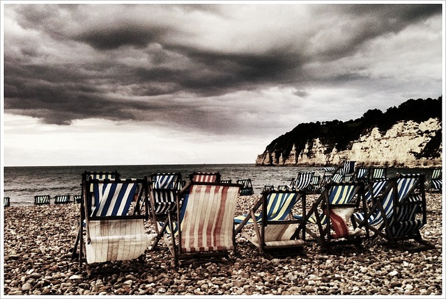 Empty deck chairs on Beer Beach by atmoorehead, via Flickr