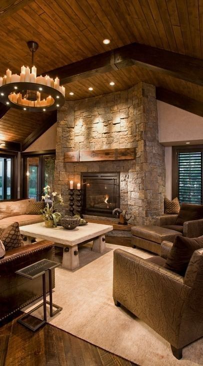 Photo of a rustic family room in Minneapolis with a stone fireplace surround. — Houzz
