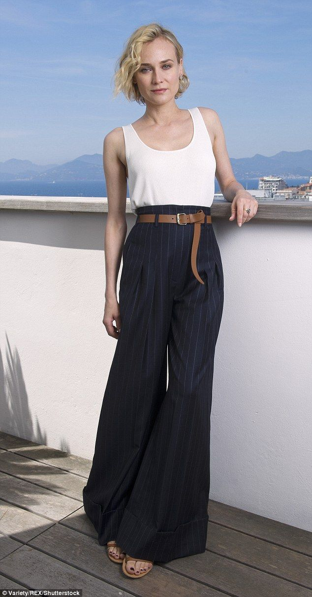 Chic: Diane Kruger looked effortlessly stylish in pinstriped palazzo trousers and a white ...