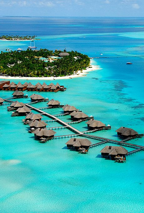 Brides.com: . 2. Maldives    These atolls in the Indian Ocean have a Robinson-Crusoe-meets-luxury vibe, with tiny palm-covered isles that are each topped with a luxury resort, often with thatched roofs that add to the faraway feel. The can't-be-beat diving is just a bonus.
