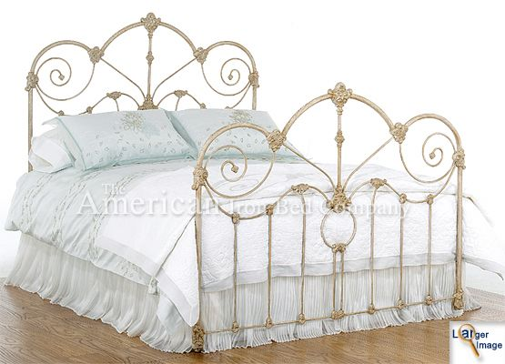 antique iron bed...looks alot like mine that was my grandfathers when he was growing up. ♥