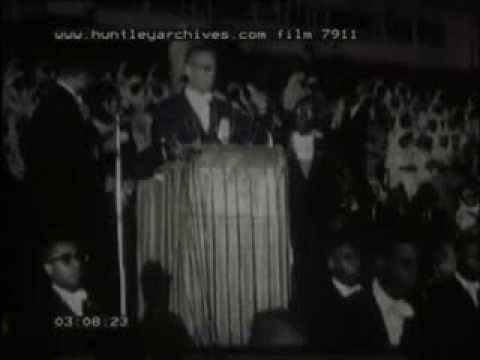 June 1961: Rare footage of Malcolm X raising funds for the Nation of Islam at the Uline Arena on 25 June 1961 during which he delivered an address titled 'Separation or Death'. The rally is noteworthy for its having been attended by George Lincoln Rockwell of the American Nazi Party and during which Rockwell made a $20 donation to the NOI.