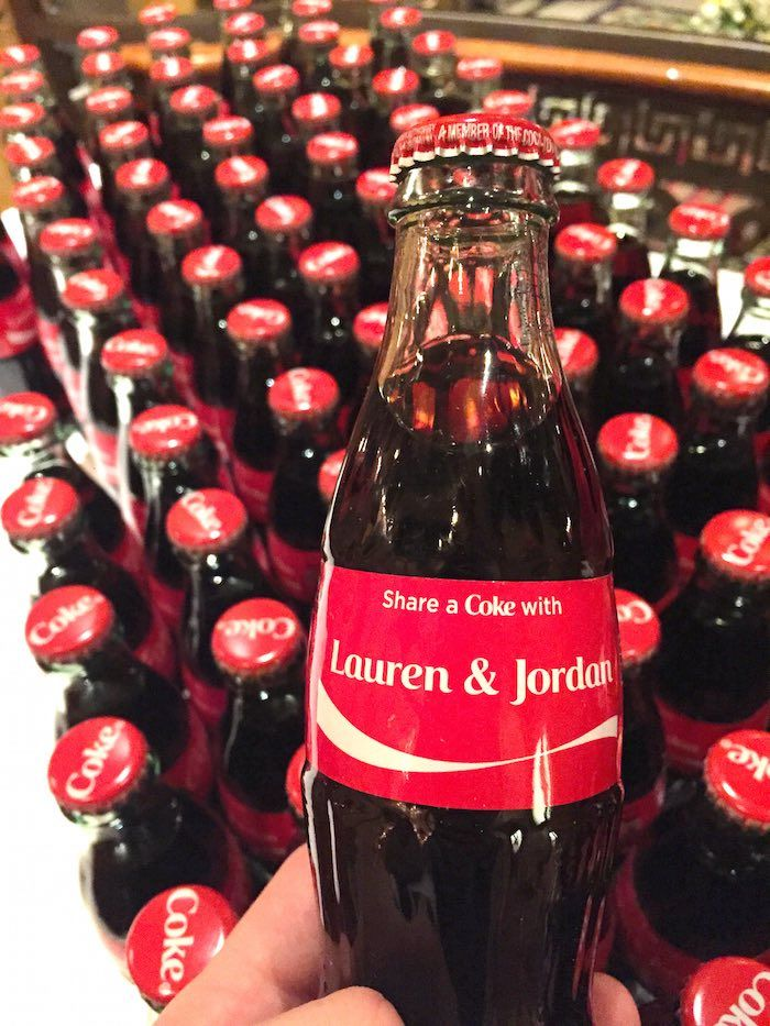 Personalized coke bottles are a clever idea guests will love! Photography: Mark C. Owen