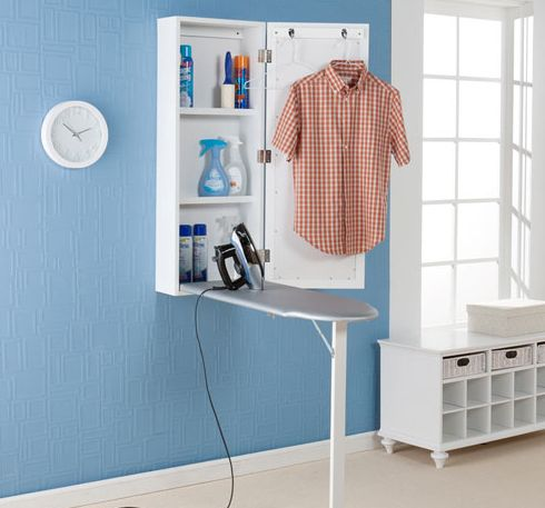 An ironing board that folds up into a mirrored cabinet. | 25 Ingenious Products That Will Save You So Much Space
