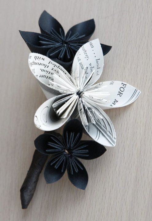 How to make a recycled paper flower. http://ecosnobberysucks.com/2011/10/how-to-make-recycled-paper-flowers-for-a-wedding-bouquet/