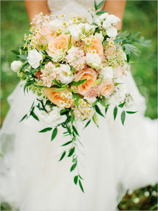 cascading peach and white bouquet featuring roses, lisianthus and chamomile by Metropolitian Market