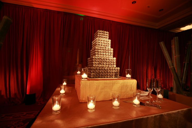 Enhanced Lighting installed beautiful red silk drapery to create a special room at this Ritz SF Wedding.  The cake was lit with pinspotting.