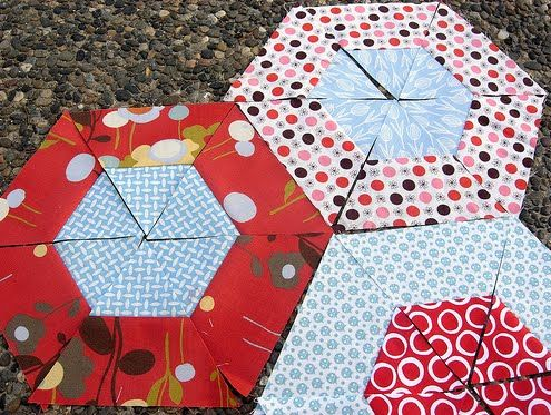 have you seen the hexagon quilt a long  flickr pool??  lots of triangles getting cut!  here are a few...   Uploaded on  April 11, 2010   by ...