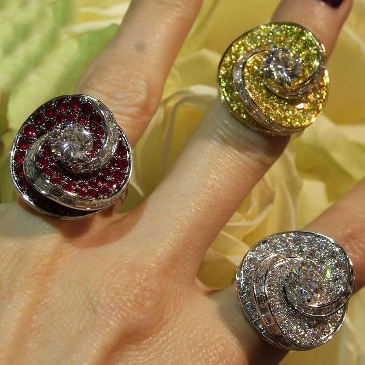 Graff Helter Skelter diamond rings, in red ruby, yellow or white diamond. Surrounded by baguette diamonds in a swirling shape, these fun rings we saw at Baselworld surrounded by cream roses. The best fashion forward jewellery moments from Baselworld day 1: http://www.thejewelleryeditor.com/jewellery/top-5/baselworld-jewellery-day-one-highlights/ #jewelry