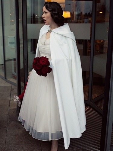 Love the cape and the hair- nice for winter wedding, although I would like to hold it on VE Day I have no objections to a Pearl Harbor wedding