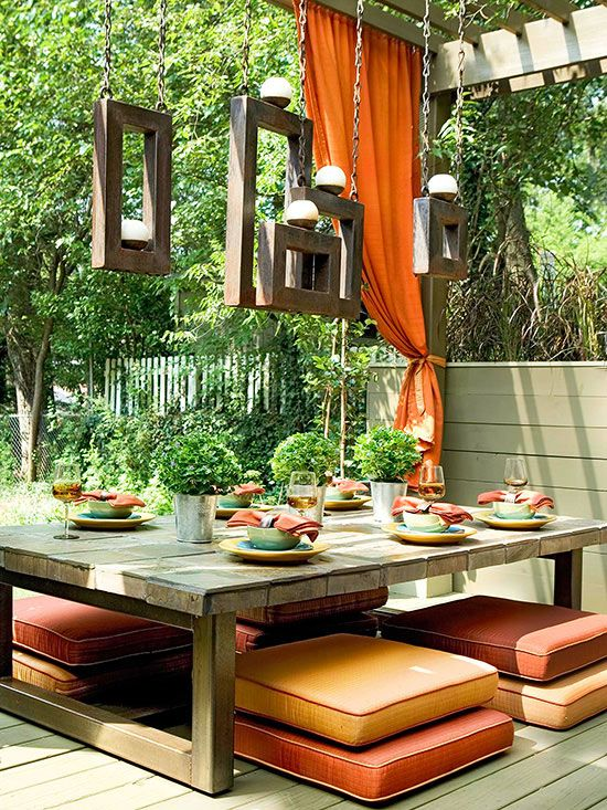 a low streamlined table makes this patio a cool and modern space http - Orange Garden Decor