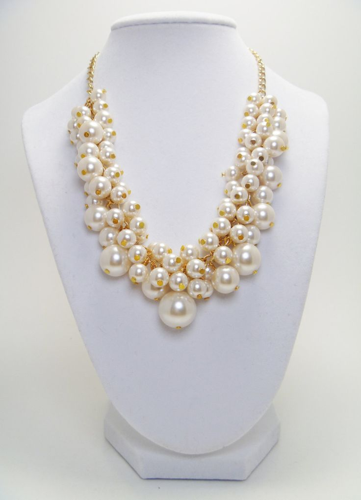 bridesmaids?  Ivory/Off White Pearl Cluster Necklace - Gold tone chain elegant bridal, bridesmaids, weddings chunky beaded necklace.. $26.00, via Etsy.