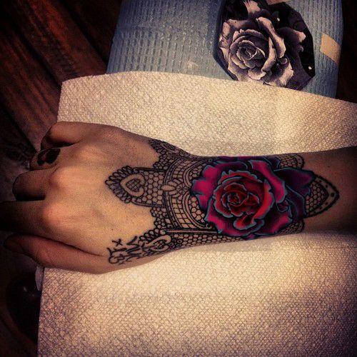 Ornamented Rose on Wristhttp://www.pairodicetattoos.com/wrist-rose-with-ornaments/