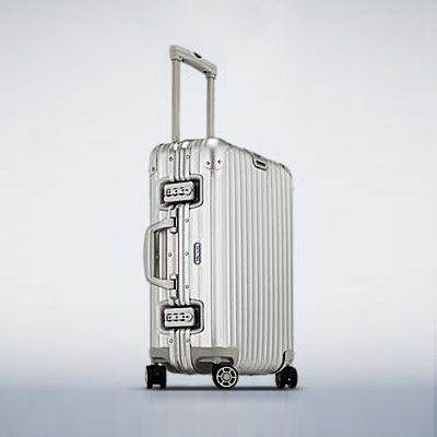 """Luggage — """"I love Rimowa's Topas line, but I really recommend any roller suitcase with wheels that turn in every direction and make it easy to navigate through airports and hotels."""""""