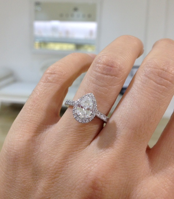 Pear shape diamond engagement ring & diamond on the
