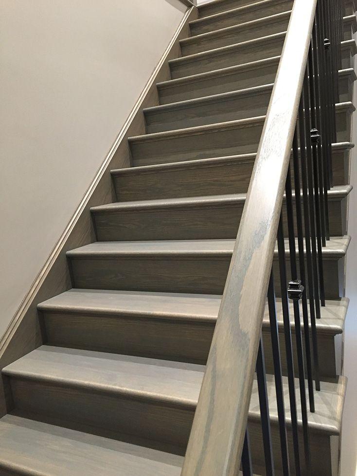 Grey Oak: Custom grey oak stained staircase finished with Varathane Nano Defence water based polyurethane matte finish.