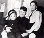 """North Korea's """"Respected and Beloved Leader"""", Kim il-Sung, photographed with his first wife, Kin Jong-Suk, and his son, Kim Jong-il, photographed while father and mother were still in service with the Soviet Red Army, 1944/'45. The lack of clarity as to date derives from North Korean myth-making, which leaves uncertainty of as much as a year as to the date birth of Kim Jong-il; he was certainly born while his father was in Soviet service but when, exactly, is uncertain. Having presided over…"""
