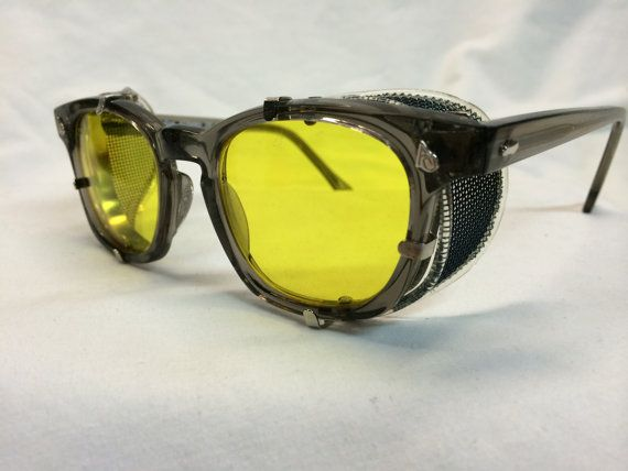 Brand new American Optical Gray Frame, with Authentic AO detachable Side Shields YELLOW Polycarbonate lenses (new, no prescription) SAFETY GLASSES Authentic AO Safety  Frame is 46-20 eye size Measures approximately 144mm side to side LIMITED SUPPLY - WHEN THEY ARE GONE, THEY ARE GONE!   SHIPPING We ship immediately upon receipt of payment CONUS orders are shipped USPS first class International orders are shipped via USPS Priority International and fees are calculated according to location…