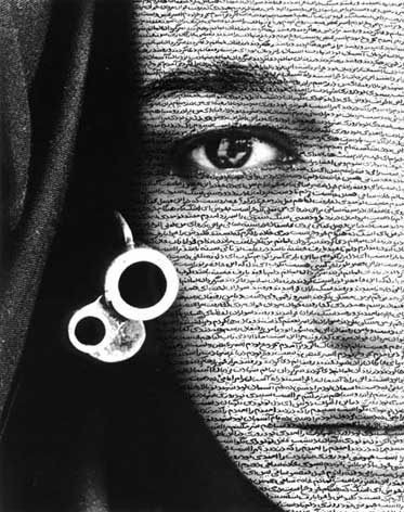by Shirin Neshat, Museum of Fine Arts, Boston, December 2013. There is very small text written across her face which is very hard to read however it looks quite effective.
