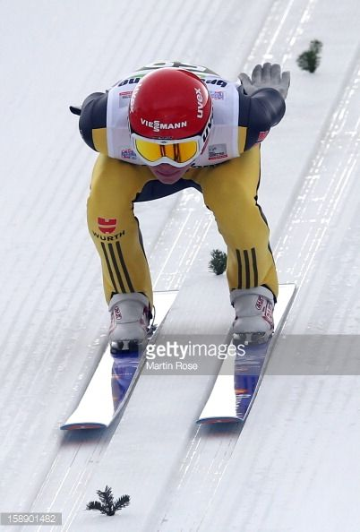 Andreas Wellinger of Germany competes during the training round for the FIS Ski Jumping World Cup event of the 61th Four Hills ski jumping tournament...