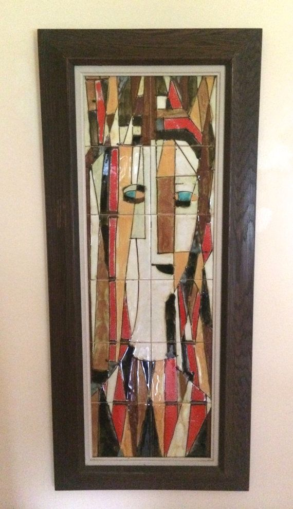 Vintage , Original work by harris Strong.. 12 ceramic tiles make up an abstract womens face . Measures 43 x 19.. Excellent condition.. no chips or
