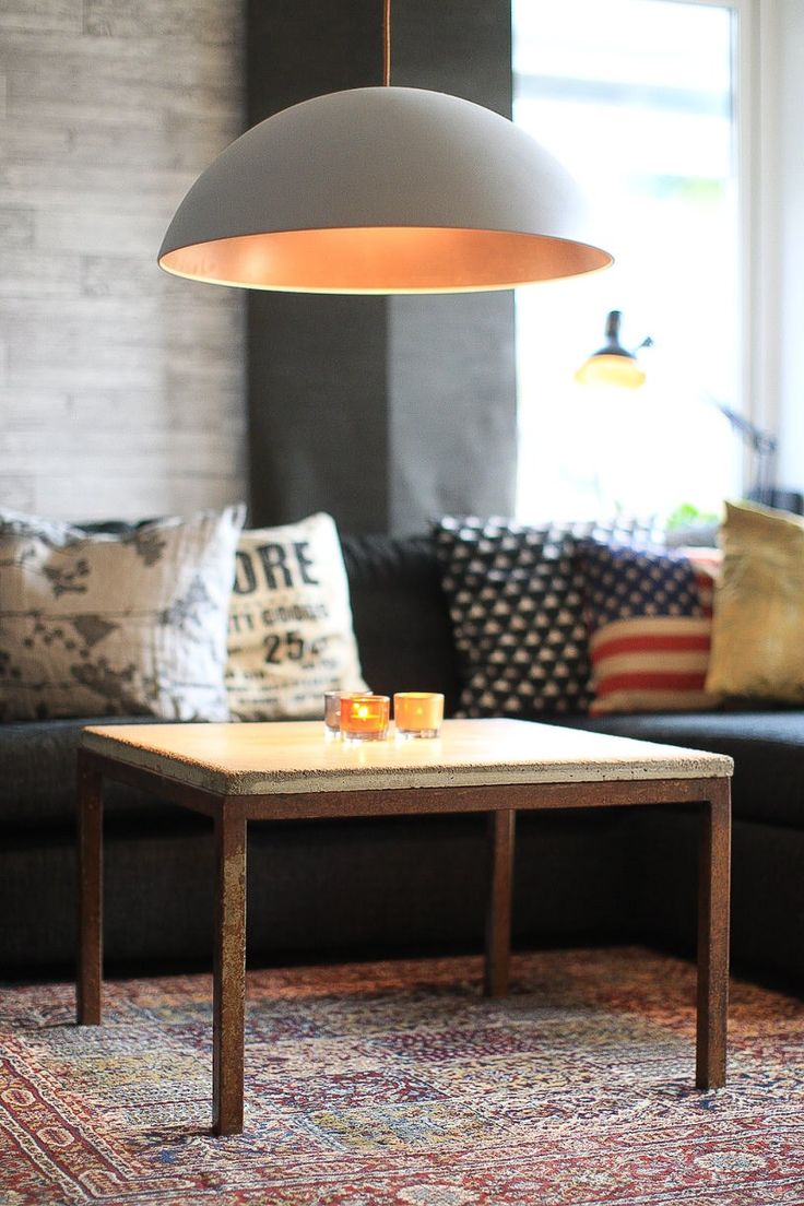 /u/dempanu I made a table for our livingroom. It has a rusty welded steelframe and and a concrete slab. The lamp is a IKEA 365+ Brasa that i spray painted grey on the outside and copper on the inside. I also changed tihe wiring to one with coper textile casing.