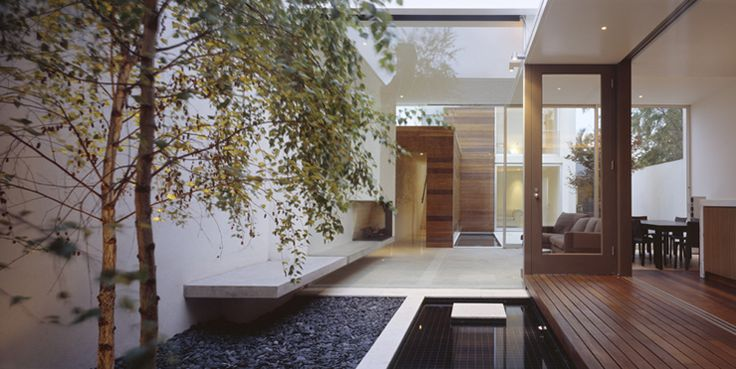 Internal garden, glazing and light filled walkway. Berkeley Dobson House by Coy + Yiontis Architects