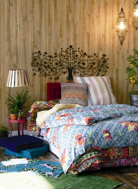 Bohemian Bedroom---fun to overlay rugs and bedding