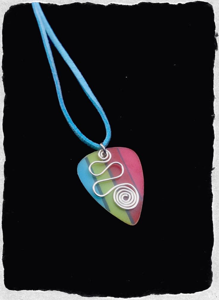 Curly Colourful Plectrum Necklace by washdupwondrs on Etsy https://www.etsy.com/listing/246897177/curly-colourful-plectrum-necklace