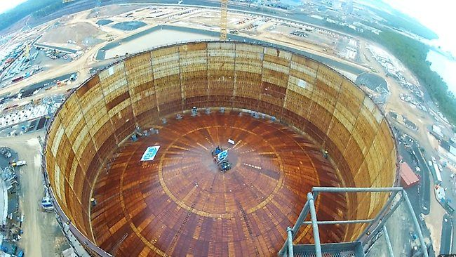 LNG storage tanks at Australia's Curtis Island: The roof (88 m diameter...that's 290 feet!) was raised by 5 large fans. It took 8 hours. There are two tanks at 50,000,000 gallons each!