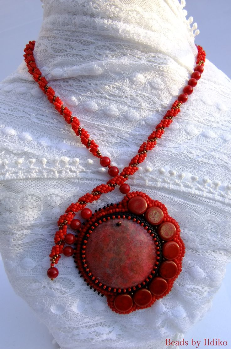 I used coral caboshon and balls creating this partly bead embroidered necklace.