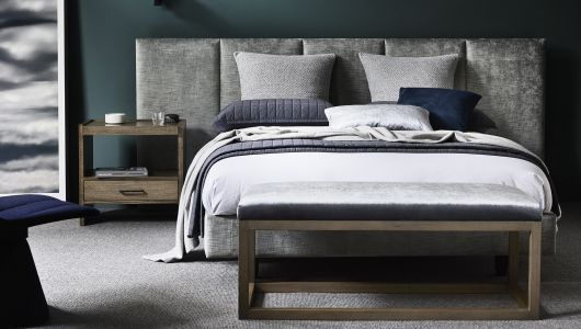 Heatherly Design; Oslo Bedhead in Velvet Valentino Silverstream. Inspired by clients who wished to recreate the feel they get from luxury hotels when traveling in their own home. Made up of 5 panels upholstered in an elegant new Italian ribbed velvet called 'Valentino'. Very clean lines; sits at 1100 high
