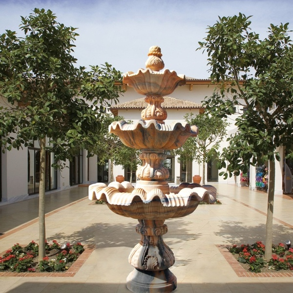 The queen of three tier fountains carved in portuguese pink marble, of exceptional hardness and cristalisation. Every three tier fountain has some element prensent in this exceptional and classic design. Please check the link below for profile with a photo in our premises in Marbella, Spain.