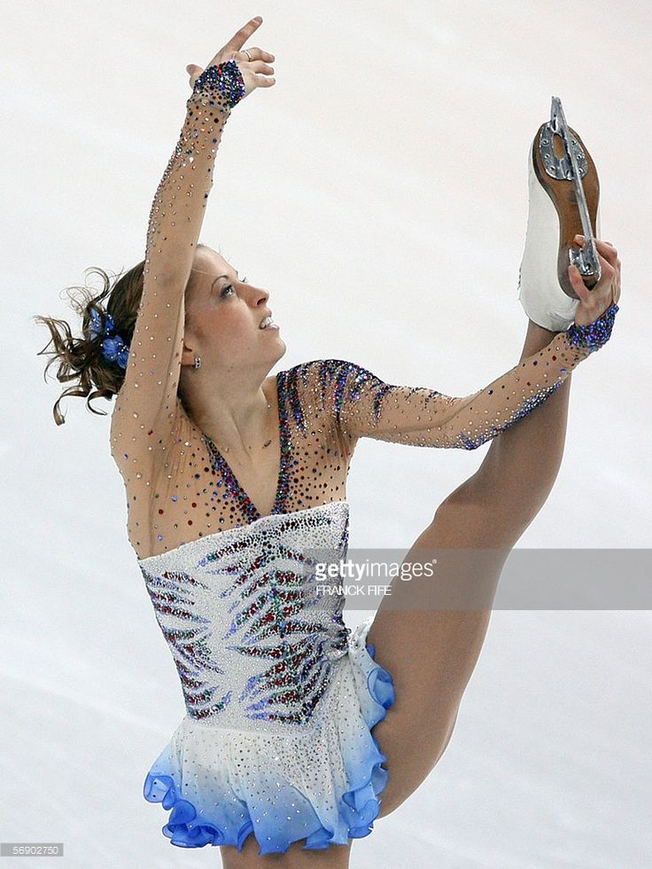 Italy's Carolina Kostner performs in the Ladies short program during the Figure Skating competition at the 2006 Winter Olympics, 21 February 2006 at the Palavela in Turin.