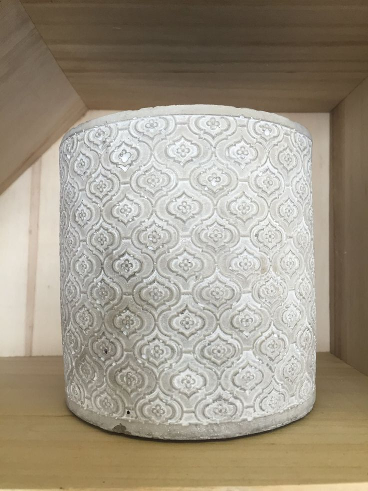 Hurricane ceramic candle holder with embossed design.