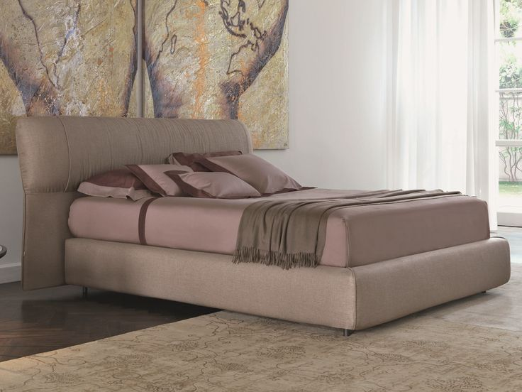 SOFTWING Letto by Flou design Carlo Colombo per cassone curvato