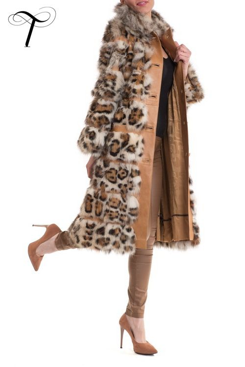 Toutountzis Furs | FOX COAT LEOPARD PRINT WITH LEATHER INSERTS  This #elegant and #fashionable coat is designed by Toutountzis Furs for any smart appearance from work to weekend. Crafted from #leopardprint #foxfur and inlayed with leather inserts for a more #graceful figure, it is cut closely to the figure with a nipped-in waist.The elaborate, optional belt allows you to cinch the waist and can be a #stylish addition to your look. It will be a contemporary addition to your #winterwardrobe.
