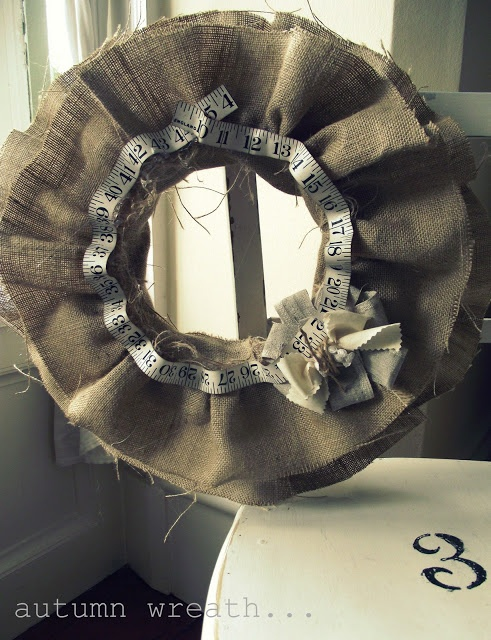 Burlap ruffle wreath with tape measure and fabric flower