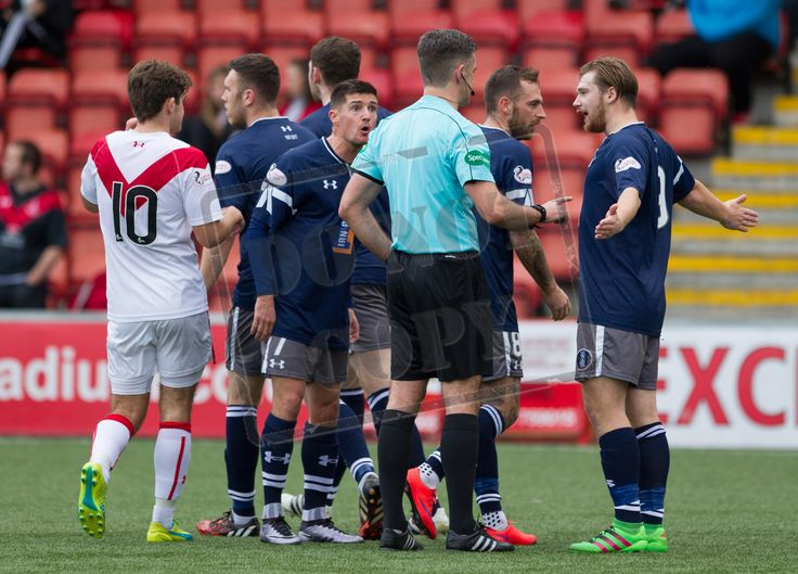 Queen's Park players discuss a point with the referee during the Ladbrokes League One game between Airdrieonians and Queen's Park.