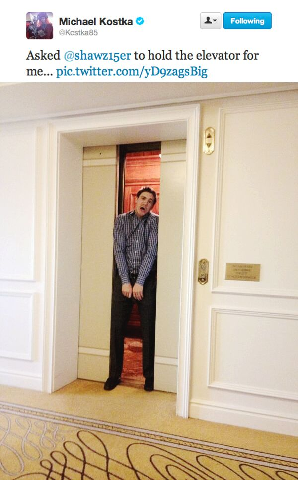 Andrew Shaw at the 2013 Chicago Blackhawks Convention holds the elevator for teammate Michael Kostka