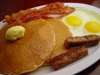 Rodeo Slam :Two pancakes, two eggs, two bacon strips, and two sausages. Served with butter and syrup from Pico Pica Rico Restaurant in Los Angeles #Food #Breakfast #Restaurant forked.com