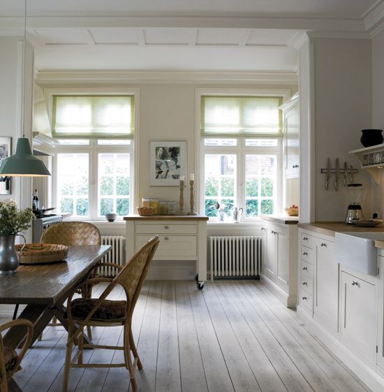 kitchen painted in three classic Farrow  Ball whites: walls are done in Slipper Satin (No. 2004), while cabinets are Pointing (No. 2003), with the skirting boards painted in Lime White (No. 1)