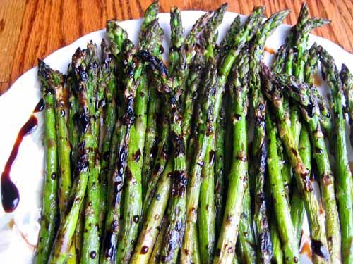 Simple glaze is made from balsamic, soy and brown sugar, then drizzled over asparagus that's been oven roasted or grilled.