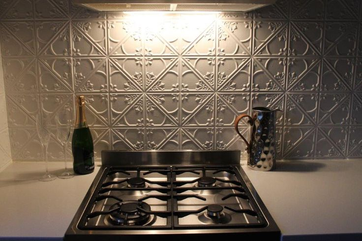 This splash back is made from the Snowflakes pressed metal design. To see more photos of the project see: http://www.heritageceilings.com.au/clients-projects/slack-splash-back-Queensland-home.php