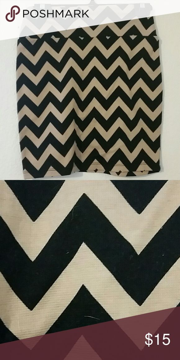 Black and Tan Chevron Skirt With a black and tan chevron pattern, elastic waistband, fairly tight and short when worn at the natural waist. Very good condition. Living Doll Skirts Pencil