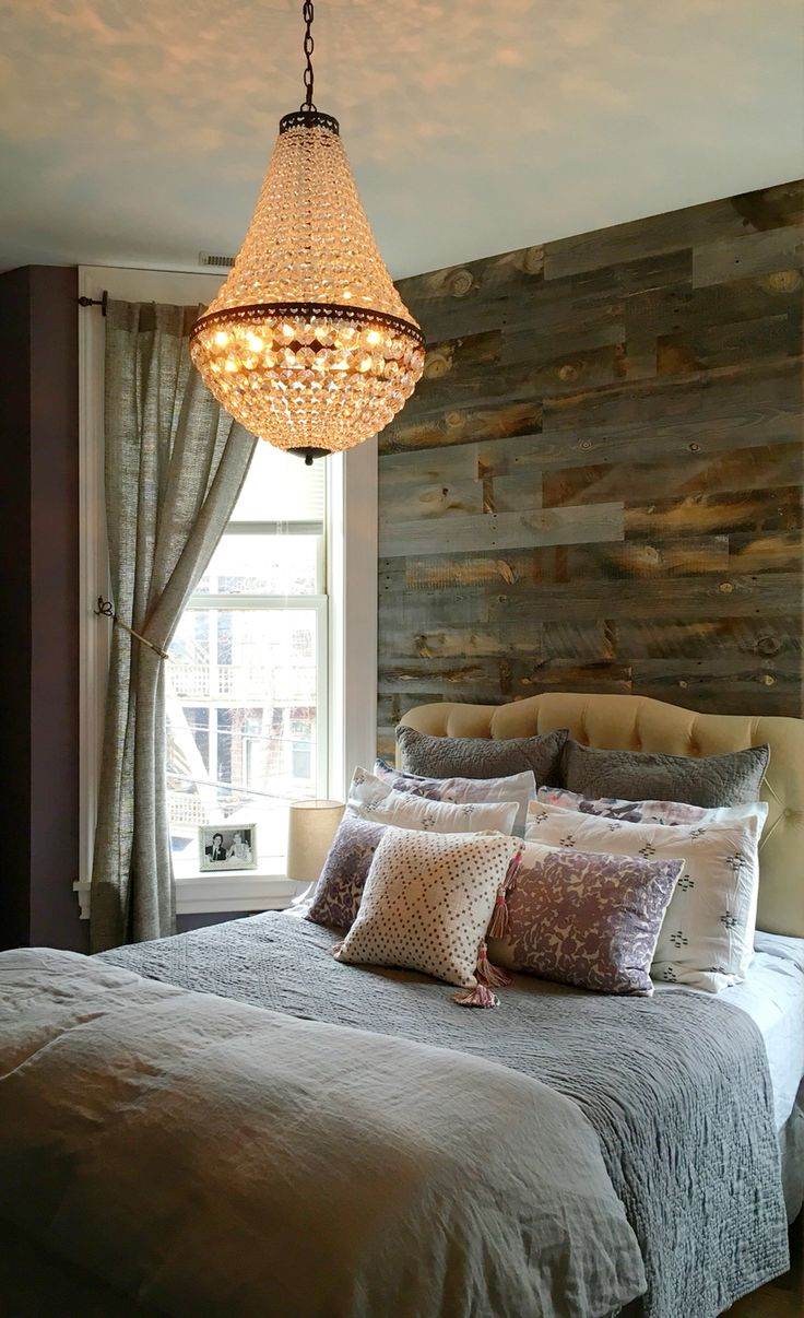Pottery Barn Mia Chandelier over the bed! One of my favorites! Rustic/industrial Stikwood wall keeps the whole look from feeling too prissy. Farrow and Ball Brassica on the walls.